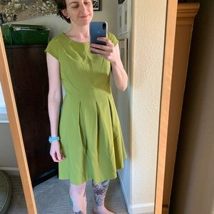 Structured green dress with exposed zipper